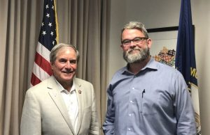 Representative John Yarmuth and host James Miller